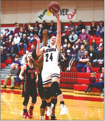 Caitlin Betak goes up for two points early in Monday night's playoff game against Brazos.<br />            Photo by Stephanie Steinhauser